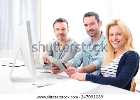View of a Young attractive people working together at the office