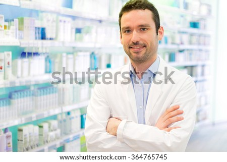 View of a Young Attractive pharmacist at work - stock photo