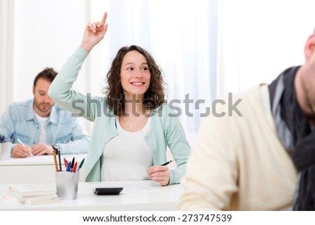 View of a Young attractive student want to ask a question - stock photo