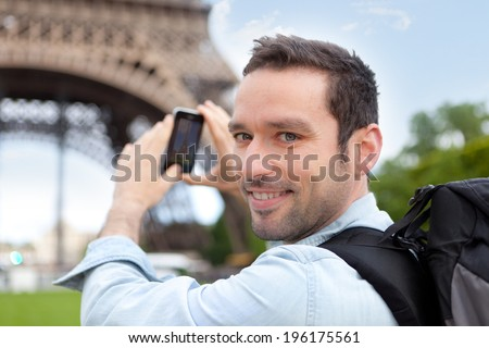 View of a Young attractive tourist taking picture in Paris - stock photo