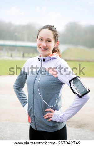 View of a young attractive woman after a running session - stock photo
