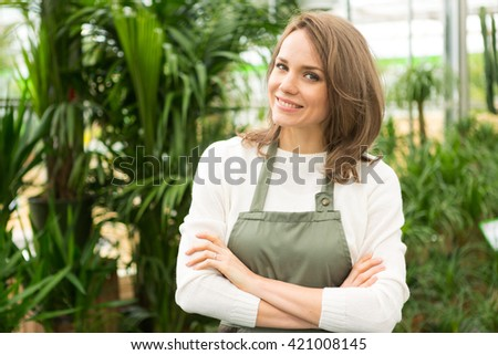View of a young attractive woman at the plants nursery