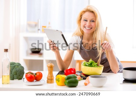 View of a Young attractive woman cooking in a kitchen - stock photo