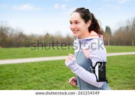 View of a Young attractive woman running at the park - stock photo