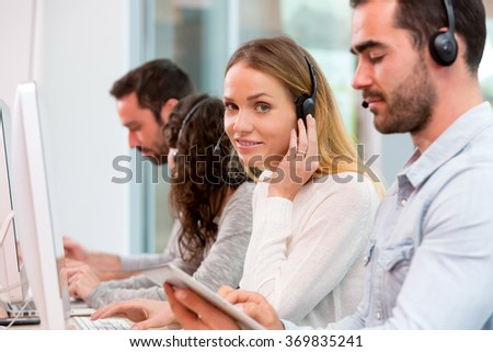 View of a Young attractive woman working in a call center - stock photo
