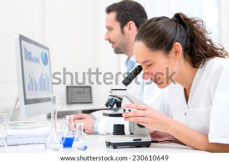 View of a Young attractive woman working in a laboratory