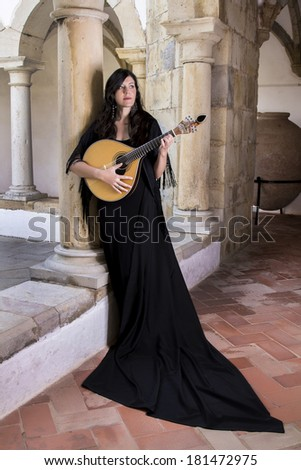 view of a young beautiful singer and performer woman of traditional Portuguese Fado music.
