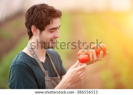 View of a Young business farmer working at the farm - stock photo