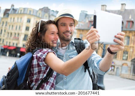 View of a Young couple on holidays taking selfie