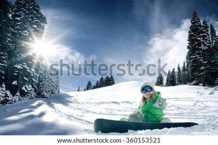 view of a young girl snowboarding in winter environment - stock photo