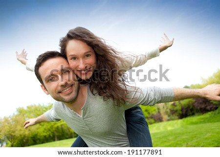 View of a Young happy couple having fun at the park - stock photo