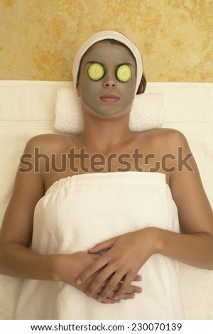 View of a young woman having a facial - stock photo