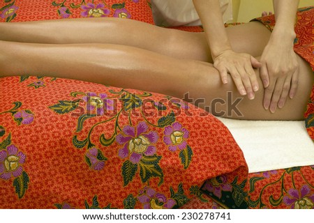 View of a young woman having a leg massage - stock photo