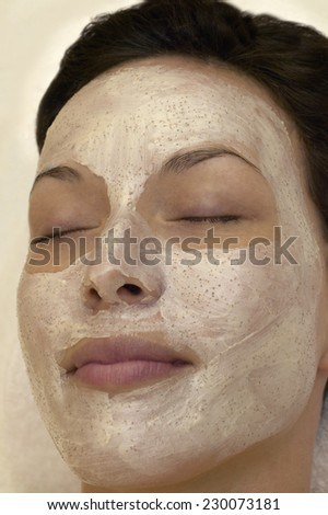 View of a young woman with a facial mask on - stock photo