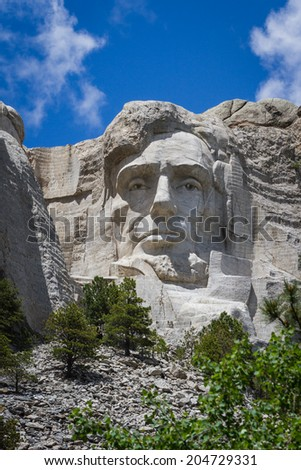 view of Abraham Lincoln at Mount Rushmore National Monument in South Dakota - stock photo