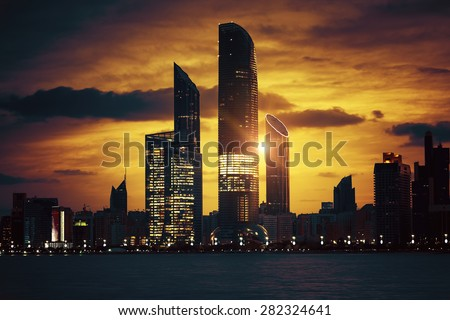 View of Abu Dhabi Skyline at sunset, United Arab Emirates, special photographic processing.