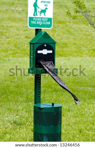 View of advisory signs in public place with complimentary bags and receptacle. - stock photo