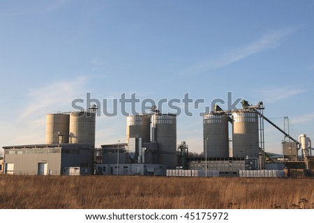 View of agriculture silos against blue sky