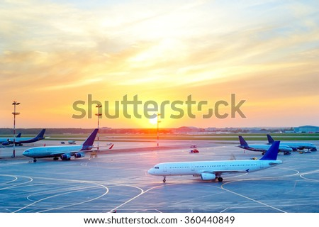 View of Airplanes at airport in the beautiful sunset - stock photo