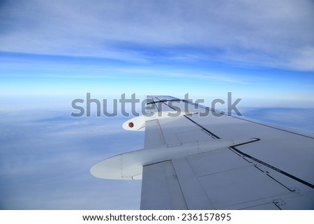 View of airplanes wing from the window, aerial photography - stock photo