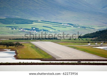 View of airport runway from the seaside, Akureyri - Iceland - stock photo