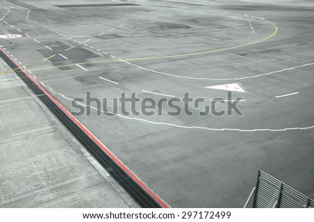 View of airport runway from window of airplane - stock photo