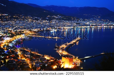 View of Alanya harbor form Alanya peninsula. Turkish Riviera by night - stock photo