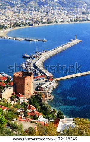 View of Alanya harbor from Alanya peninsula. Turkish Riviera - stock photo