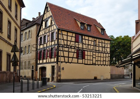 View of Alsace typical traditional street with tradition house in Colmar, France - stock photo