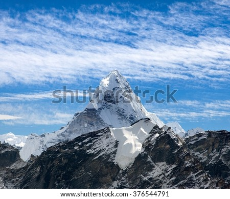 View of Ama Dablam on the way to Everest Base Camp with beautiful cloudy sky, Sagarmatha national park, Khumbu valley, Nepal - stock photo