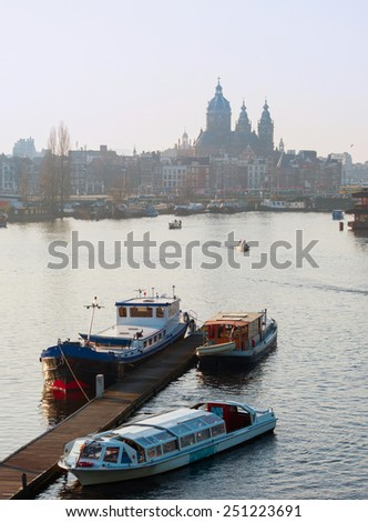 View of Amsterdam with boats on Amstel river. Holland - stock photo