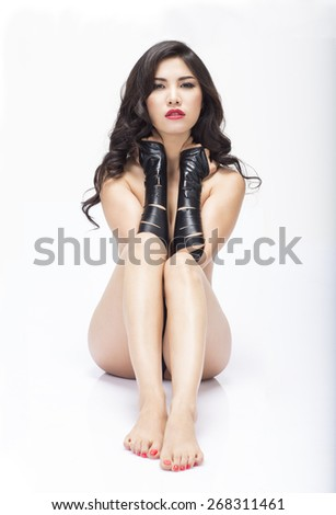 View of an asian girl sitting on reflective white floor