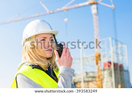 View of an attractive woman worker on a construction site  - stock photo