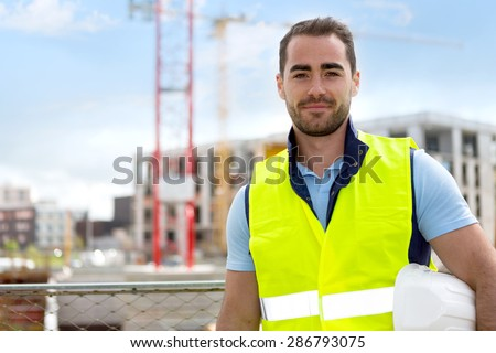 View of an attractive worker on a construction site  - stock photo