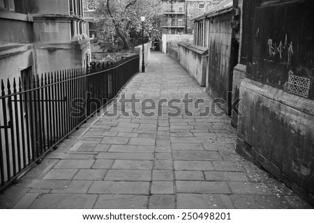 View of an Empty Dark Inner City Alley - stock photo