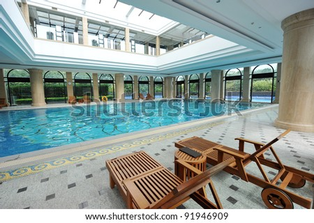view of an indoor pool at a hotel - stock photo