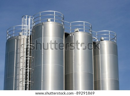 View of an industrial plant with large aluminum tanks