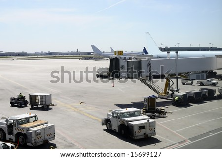 View of an international airport with planes in parking position - stock photo