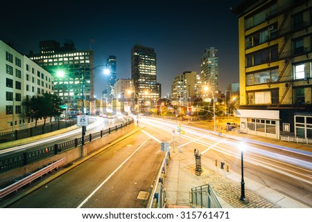 View of an intersection in SoHo at night, in Manhattan, New York. - stock photo