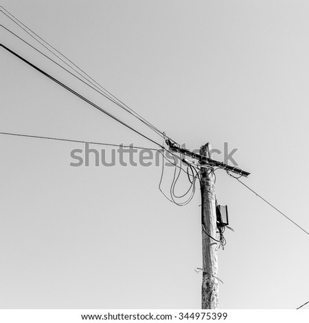 view of an old electric pole with wire