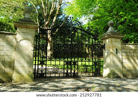 View of an Old Ornate Gateway to an English Country Estate  - stock photo
