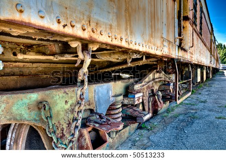 View of an old rusted train abandoned in a track. - stock photo