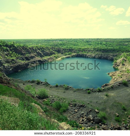 view of an open pit mining, Ukraine. instagram effect, square image - stock photo