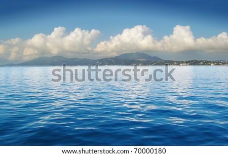 View of an open sea with a cloud on Corfu island, Greece - stock photo