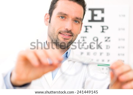 View of an Ophthalmologist make you try new glasses - stock photo