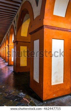 view of an orange and white arch situated on the plaza de la corredera in the spanish city cordoba