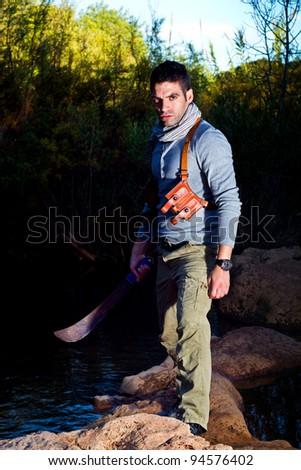 View of an treasure hunter, jungle adventurer type man. - stock photo