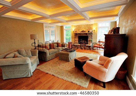 View of an upscale living room interior with a box beam ceiling. Horizontal format. - stock photo