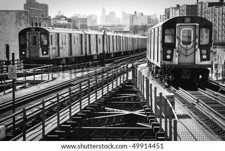 View of an uptown and downtown elevated subway trains. - stock photo