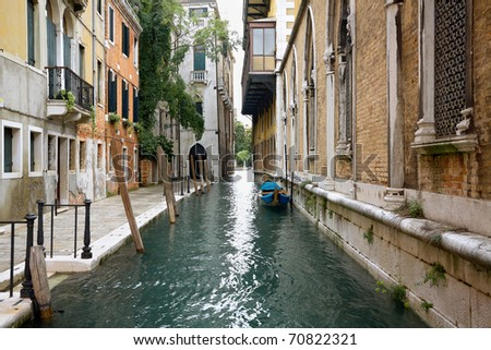 View of ancient buildings and narrow canal with gondola.Venice - stock photo